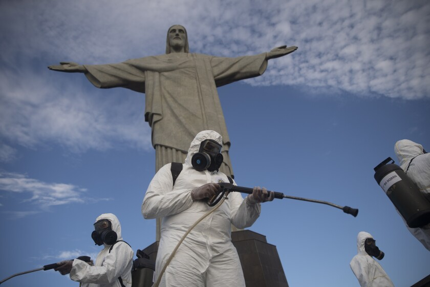Soldiers disinfect the Christ the Redeemer site, currently closed, to prepare for what tourism officials hope will be a surge in visitors in the upcoming weekend as health restrictions are eased amid the new coronavirus pandemic in Rio de Janeiro, Brazil, Thursday, Aug. 13, 2020. (AP Photo/Silvia Izquierdo)