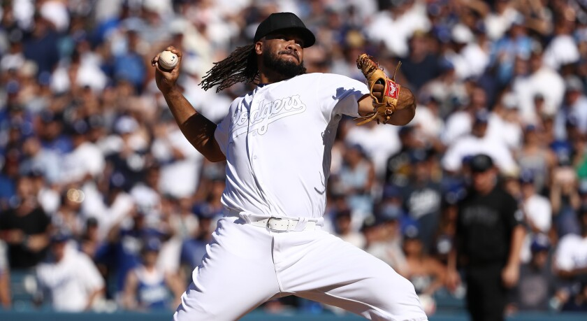 Dodgers pitcher Kenley Jansen pitches in the ninth inning against the New York Yankees at Dodger Stadium on Saturday.