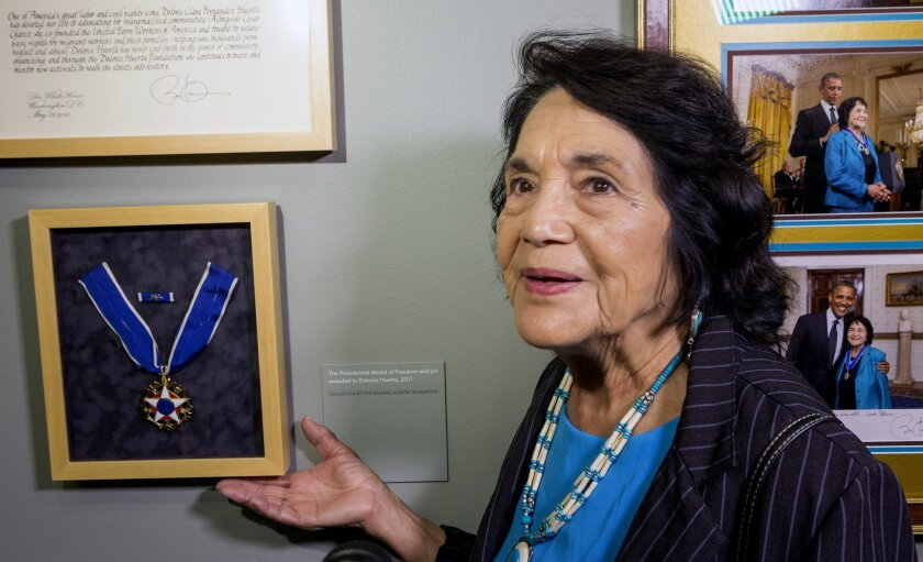 """FILE - This April 10, 2014 file photo Dolores Huerta, co-founder of United Farms Workers, shows her Presidential Medal of Freedom Award at La Plaza de la Cultura y Artes museum in Los Angeles. Civil rights icon Huerta says she holds no ill feelings toward actress Rosario Dawson over her """"open lette"""