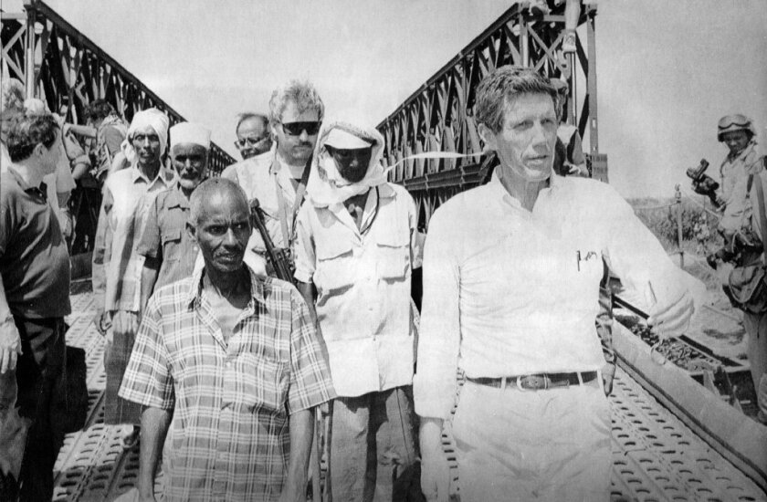 """Diplomat Robert Oakley, right, won the release of the pilot captured in the October 1993 """"Black Hawk Down"""" firefight in Somalia. He is seen here earlier that year in the country."""