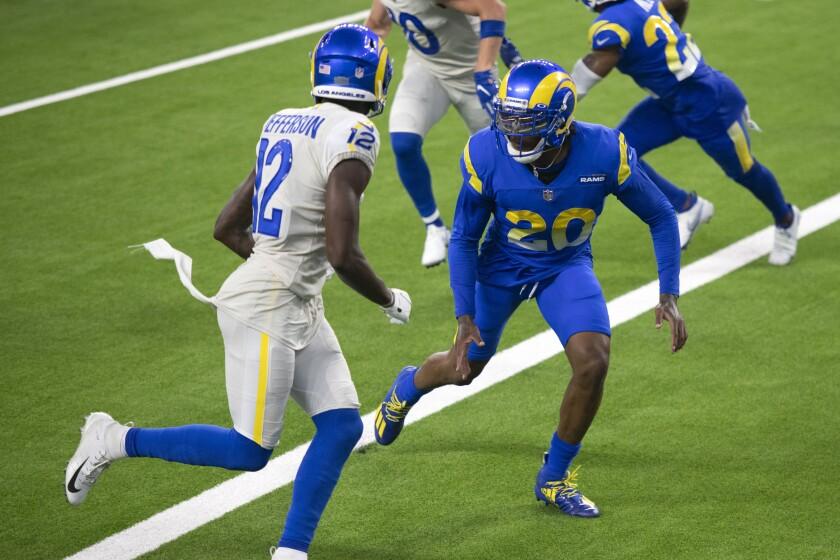 Los Angeles Rams cornerback Jalen Ramsey, right, defends wide receiver Van Jefferson.