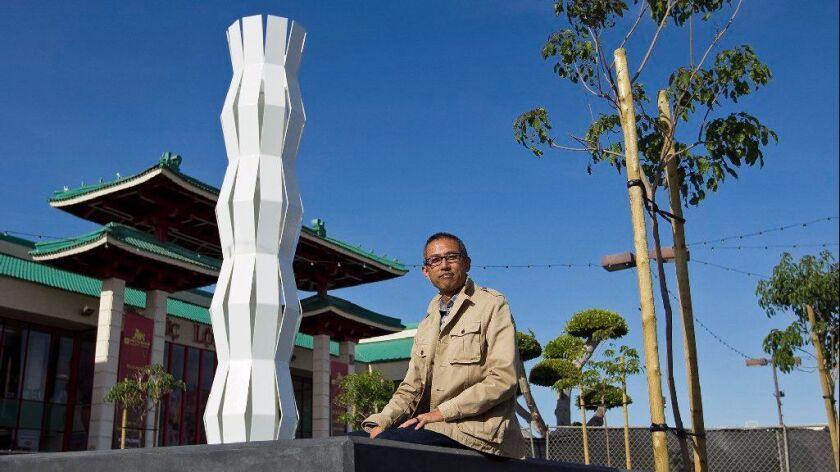 "James Dinh, an artist based in Cerritos, created the sculpture ""Of Two Lineages"" as the centerpiece of the public art project ""Courage to Rebuild"" at the Asian Garden Mall in Westminster. The project commemorates the 40th anniversary of Vietnamese migration to the United States."