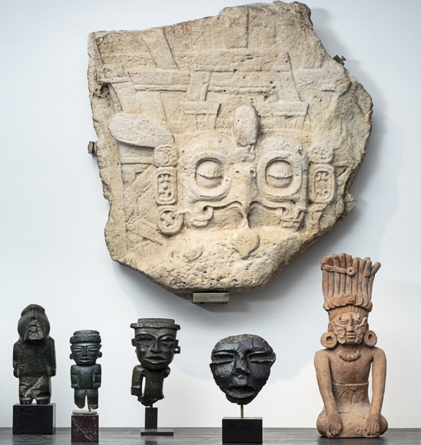 The large carved relief showing a Maya king's headdress with an owl motif is among works to be sold at auction in Paris.