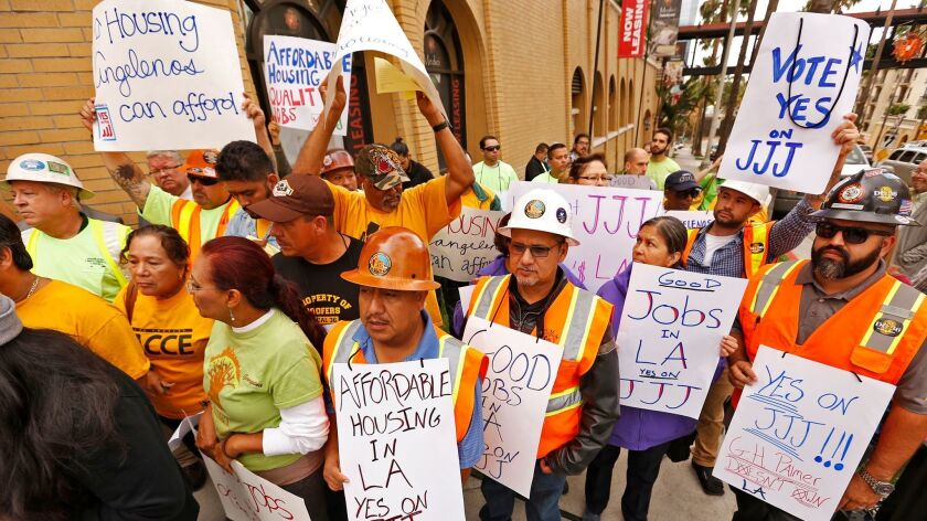 Supporters of Measure JJJ, which Los Angeles voters approved in November