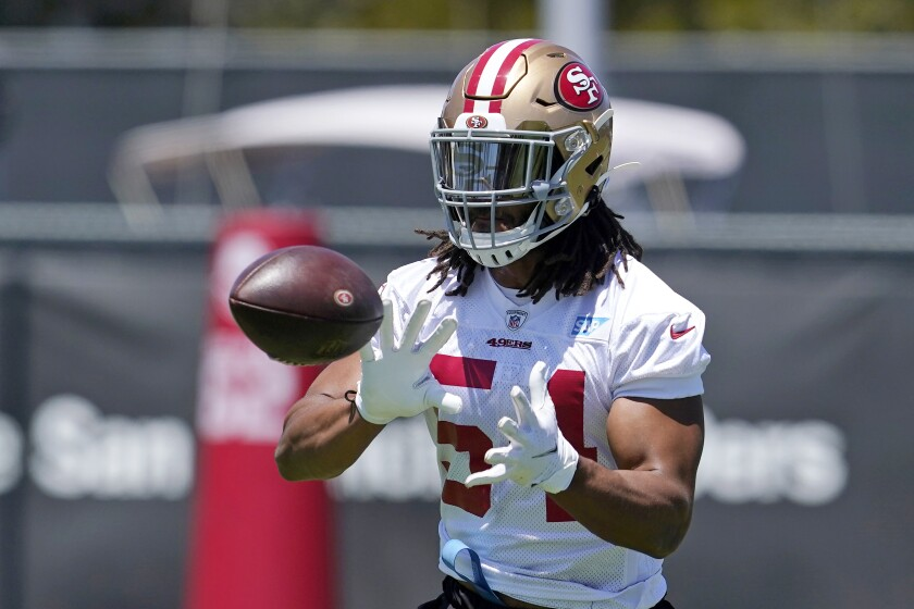 FILE - In this May 25, 2021, file photo, San Francisco 49ers linebacker Fred Warner reaches for ball during NFL football practice in Santa Clara, Calif. The 49ers agreed on a five-year contract extension with Warner that makes him the highest-paid off-ball linebacker in the NFL. A person familiar with the deal said on condition of anonymity that the extension that runs through 2026 is worth about $95 million with $40.5 million in guarantees. The person spoke on condition of anonymity because the team hadn't announced the deal yet. (AP Photo/Jeff Chiu, FIle)