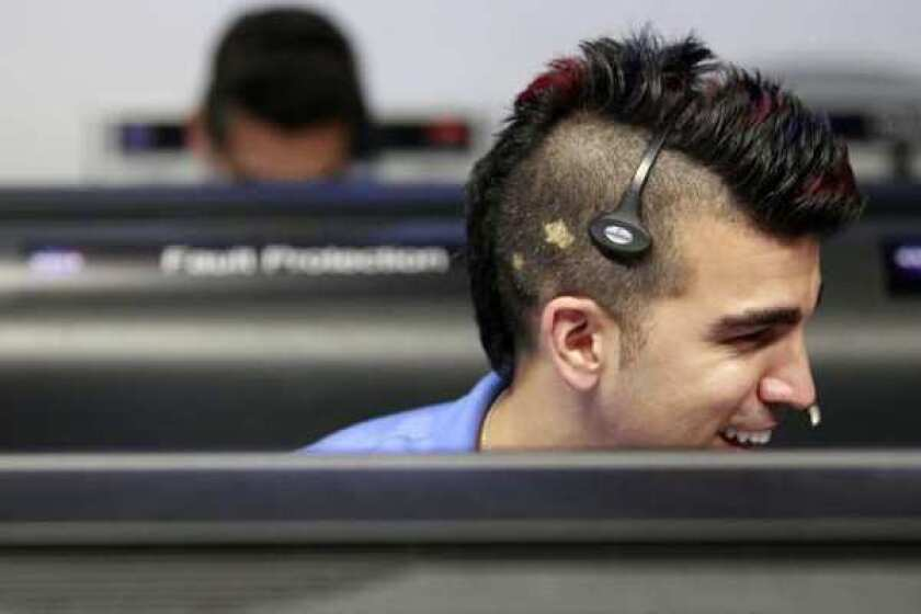 """""""Mohawk Guy"""" Bobak Ferdowsi works on the Mars Science Laboratory mission at the Jet Propulsion Laboratory on Sunday. As a flight director for the rover known as Curiosity, he gained Internet fame for his funky hairstyle."""