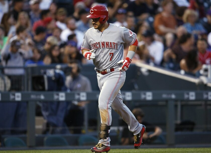 Cincinnati Reds' Eugenio Suarez circles the bases after hitting a three-run home run off Colorado Rockies relief pitcher Chad Qualls during the fifth inning of a baseball game Thursday, June 2, 2016, in Denver. (AP Photo/David Zalubowski)