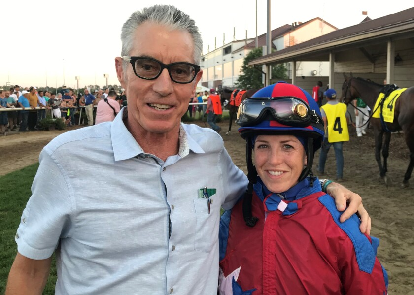 Myracehorse.com owner Robin Hoffos posed with jockey Sophie Doyle before she rode Street Brand to a victory in the Grade III Indiana Oaks.