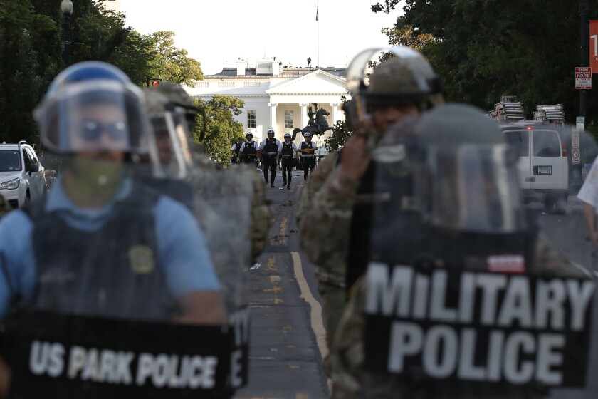 Federal police clear the area around Lafayette Square and the White House in Washington on June 1.