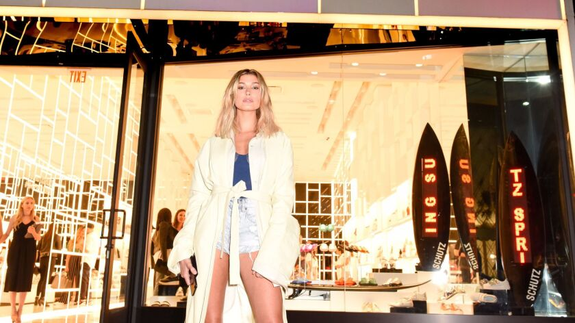 Model Hailey Baldwin stands outside the Schutz store in Beverly Hills. The Brazilian footwear brand is celebrating the store's one-year anniversary.