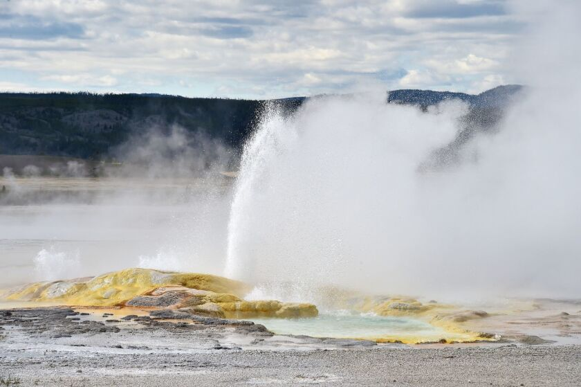A geyser in Yellowstone National Park, similar to this one, spewed decades-old garbage.