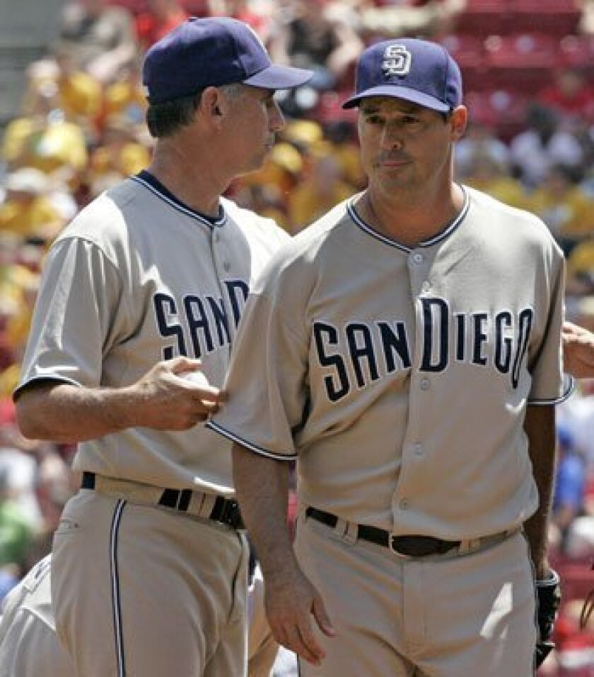 Greg Maddux, right, is pulled by manager Bud Black in the sixth inning with a 3-2 lead. One pitch later, Edwin Encarnacion hit a two-run homer off Cla Meredith to put the Reds on top.