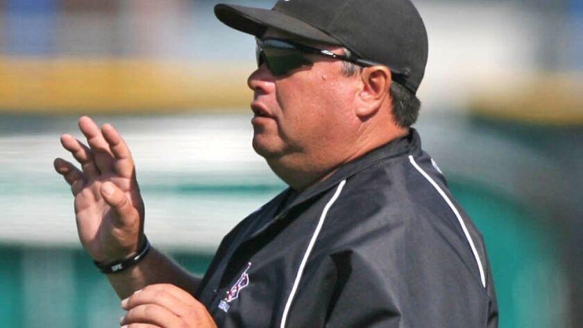 Laguna Beach head baseball coach Jeff Sears guides his team during Friday's game at Costa Mesa High