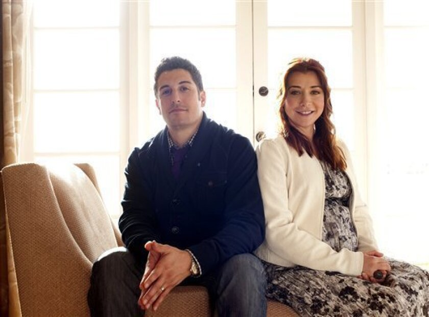 """In this March 18, 2012 photo, actors Jason Biggs, left, and Alyson Hannigan pose for a portrait during a media day for the upcoming feature film """"American Reunion"""" in Los Angeles. The film opens nationwide on Friday, April 6. (AP Photo/Dan Steinberg)"""