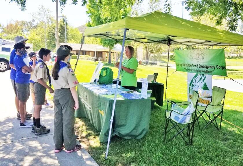 Poway Neighborhood Emergency Corps President Terri Sorensen explains emergency preparedness to a group of Boy Scouts.