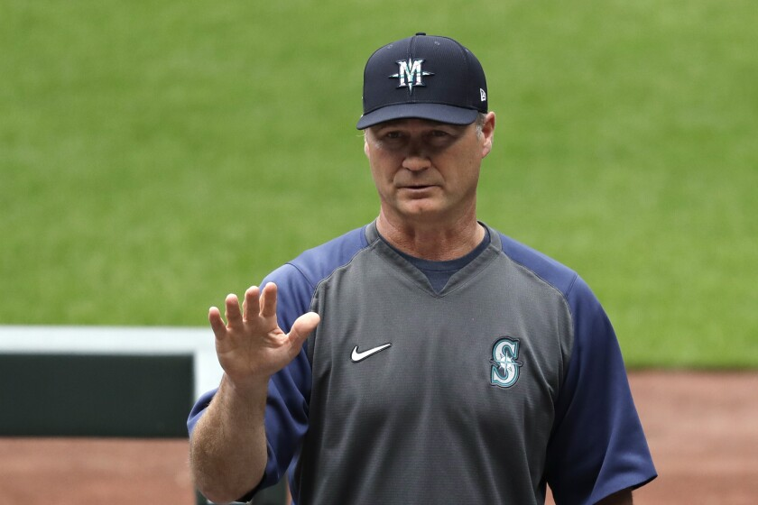 "Seattle Mariners manager Scott Servais addresses players and other team personnel before practice at a ""summer camp"" baseball workout on their ballpark field Friday, July 3, 2020, in Seattle. (AP Photo/Elaine Thompson)"