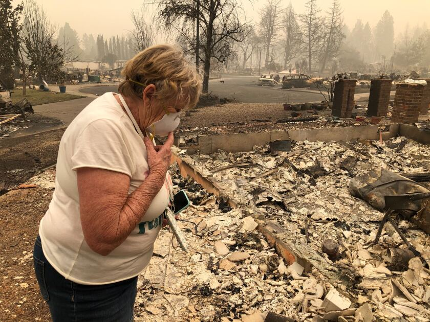 Susie McMillan, 76, evacuated before a wildfire destroyed her home on Orchard Place in Phoenix, Ore.