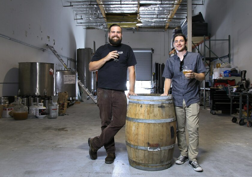 Mike Stevenson, left, and Ben Fairweather, right, founders of the Palomar Brewing Company, in their under-construction brewery. If the permitting process goes smoothly, they hope to be up and running by September.