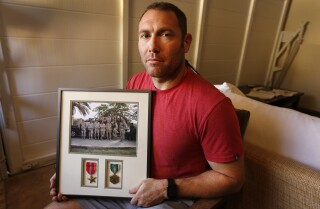 After he fought for the country, the U.S. is asking him to give back his enlistment bonus