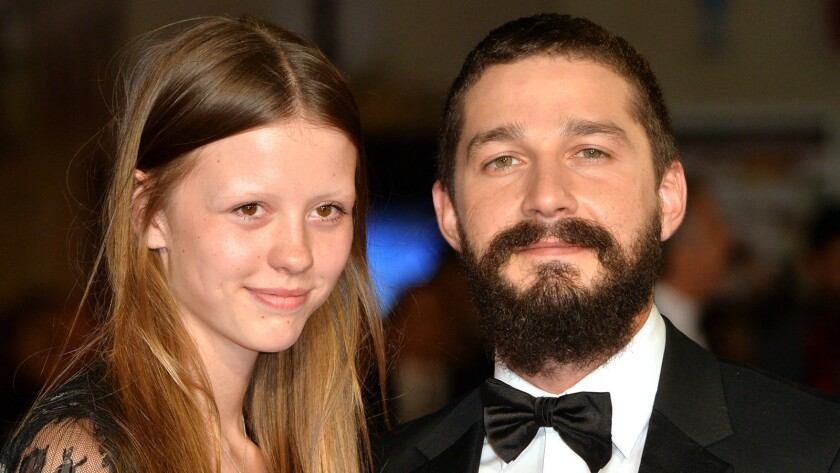 """Mia Goth and Shia LaBeouf at a """"Fury"""" screening in London in October 2014."""