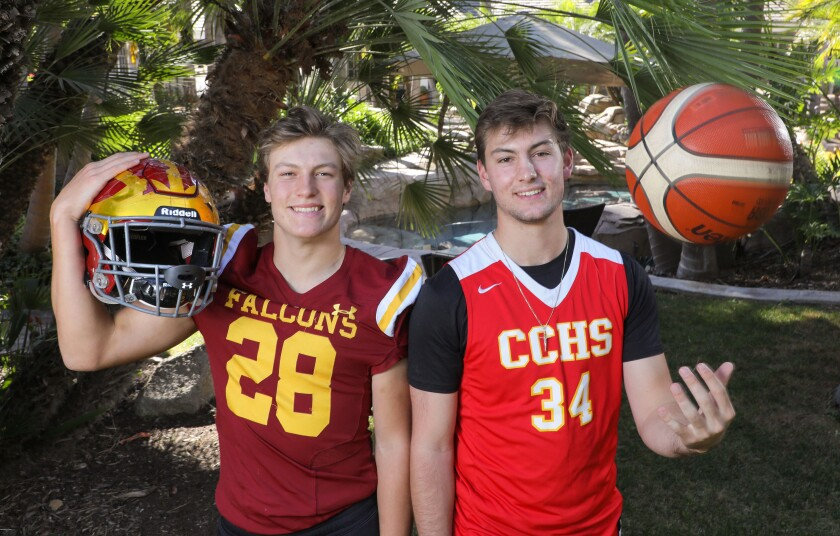 Marco Notarainni (28) plays football for Torrey Pines. Thomas Notarainni (34) plays basketball for Cathedral Catholic. With one season nearing its end and the other about to begin, the brothers took time for a portrait in the backyard of their Rancho Santa Fe home.