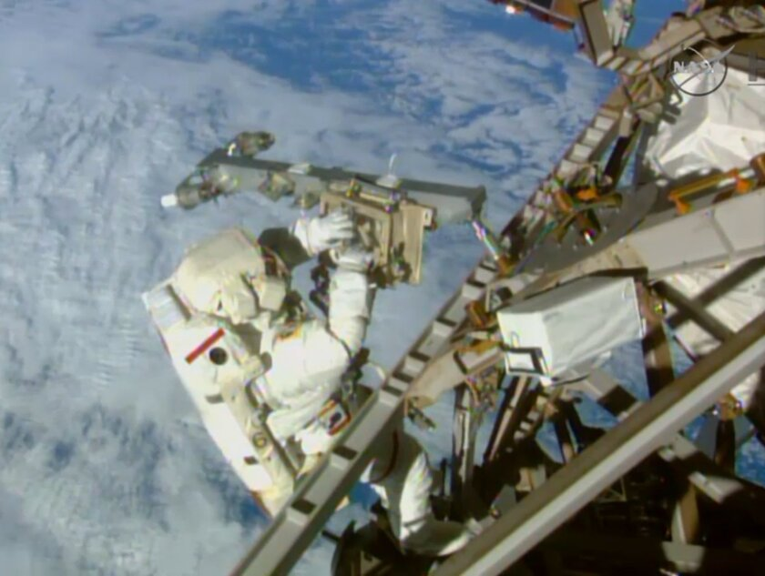 In this Sunday, March 1, 2015 image made from video provided by NASA, astronaut Terry Virts installs an antenna and boom during a spacewalk outside the International Space Station. On Friday, Feb. 19, 2016, NASA announced it received a record number of applicants _ some 18,300 _ for its next astronaut class. That's more than double the previous record of 8,000 for the first space shuttle astronaut class in 1978. (AP Photo/NASA-TV)