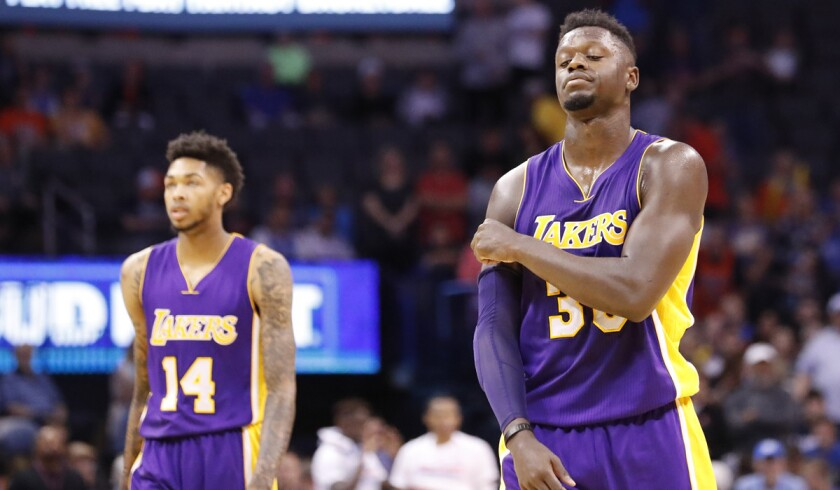 Lakers forwards Julius Randle, right, scores 20 points and Brandon Ingram contributes nine in the Lakers' 113-96 loss to the Oklahoma City Thunder.
