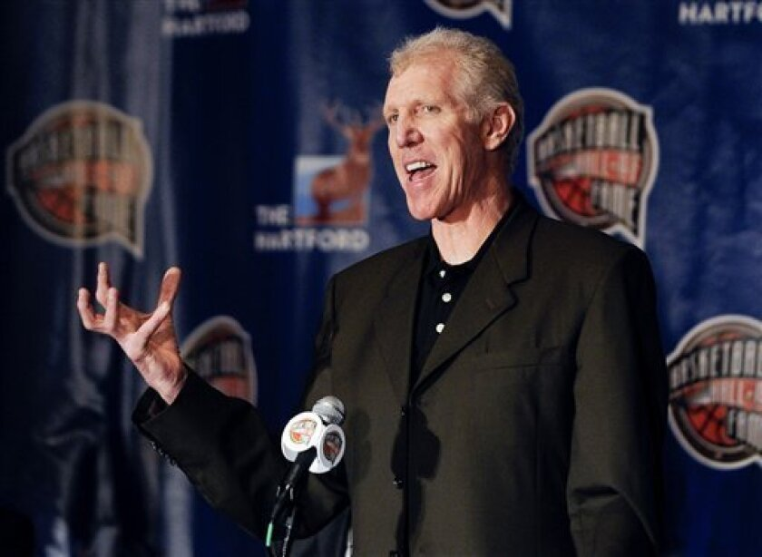 FILE - This April 5, 2010, file photo shows Basketball great Bill Walton speaking during the Naismith Memorial Basketball Hall of Fame class announcement, in Indianapolis. Walton is ready to recap his amazing career and even more amazing recovery. Simon & Schuster announced Wednesday, Oct. 3, 2012, that Walton, 59, is working on a memoir that will come out in the fall of 2013. (AP Photo/Mark J. Terrill, File)