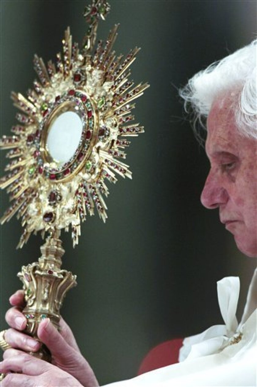 Pope Benedict XVI holds the ostensory as he celebrates a Corpus Domini mass in St. John in Lateran Basilica in Rome, Thursday, June 3, 2010. (AP Photo/Gregorio Borgia)