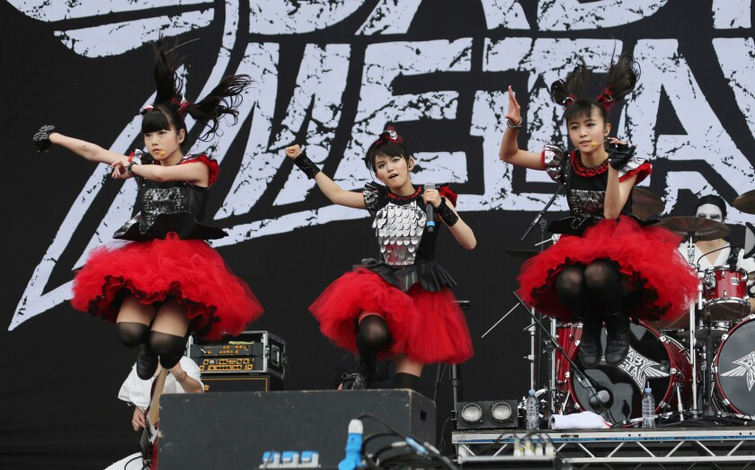 Yuimetal, Su-metal and Moametal of Babymetal perform at the Sonisphere Festival in England.