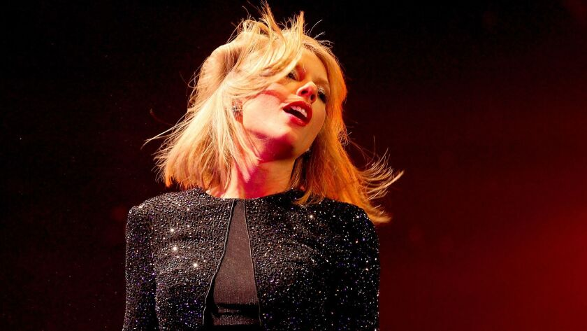 Taylor Swift performs at KIIS-FM's annual Jingle Ball concert at Staples Center.