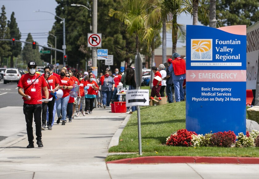 Fountain Valley Regional Hospital & Medical Center workers hold a rally outside the hospital on May 6.