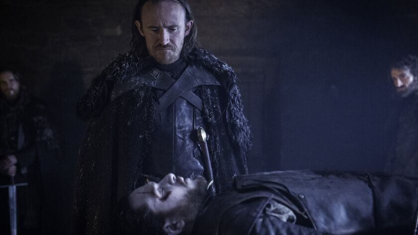 This image released by HBO shows Ben Crompton, standing, and Kit Harington in a scene from the seaso