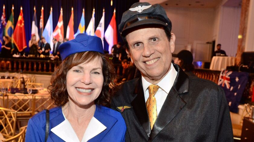Lori and Mike Milken wear airline attire in keeping with the evening's theme.