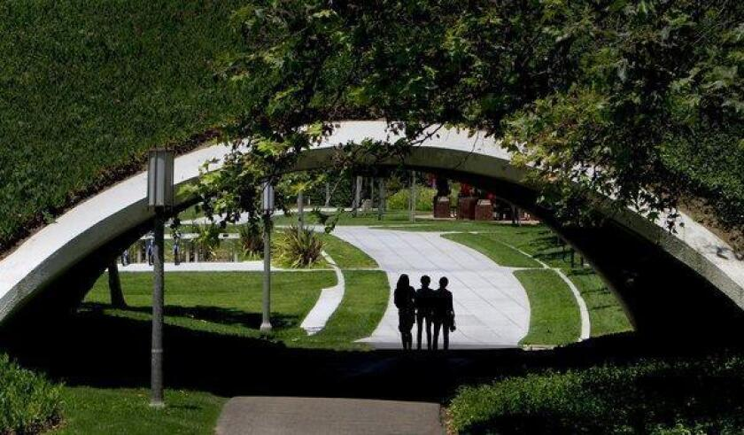 Students walk across campus at UC Irvine in 2008, the year before the law school opened.
