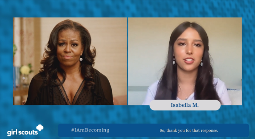 Former First Lady Michelle Obama and Girl Scout alum Isabella Madrigal.