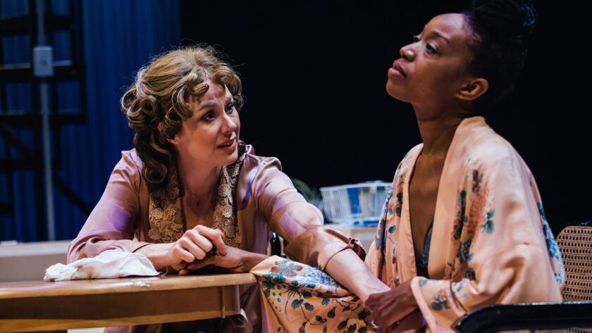 "Jaimi Paige as Blanche, left, and Maya Lynne Robinson as Stella in Boston Court's ""A Streetcar Named Desire."""