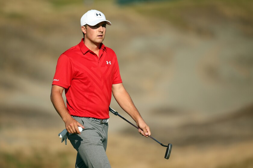 Jordan Spieth walks off the 14th green during the third round of the U.S. Open on Saturday at Chambers Bay in University Place, Wash.