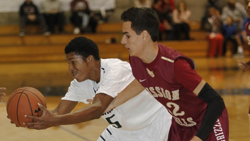 Mission Hills' Cody Hicks battles for a loose ball with Chino Hills' Bishop Mincy.
