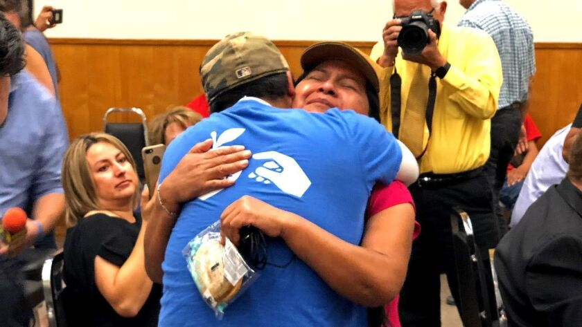 FRESNO, CALIF. -- SEPT. 18, 2018 -- Workers with the Pick Justice campaign embrace. More than 2,000