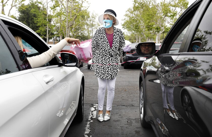 Worshipers offer prayer requests from their cars in Santa Ana
