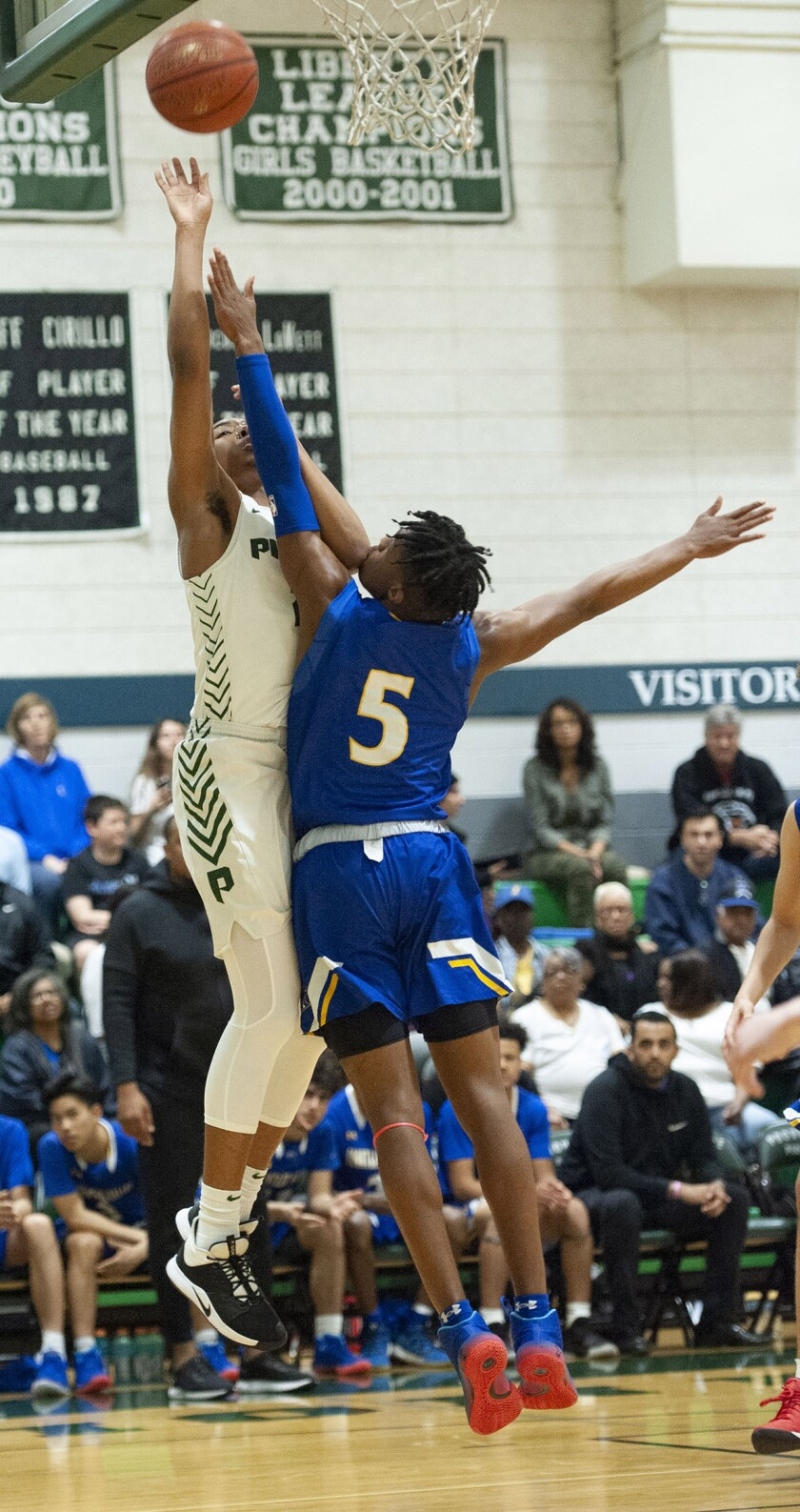 Providence's A'Jahni Levias puts the ball up over Fountain Valley's Jermiah Davis during CIF State Division III Southern California Regional semifinal at Providence High. (Photo by Miguel Vasconcellos)