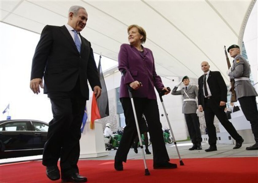 German Chancellor Angela Merkel, right, and Israel's Prime Minister Benjamin Netanyahu enter the Chancellery in Berlin Thursday April 7, 2011. Israel's prime minister is to meet Germany's chancellor amid Israeli concern that European countries will push for endorsement of a future Palestinian state in virtually all of the West Bank, Gaza Strip and east Jerusalem. German officials have said issues for discussion Thursday between Prime Minister Benjamin Netanyahu and Chancellor Angela Merkel include possible steps to break the stalemate in the Israeli-Palestinian peace process, and the upheaval in the Arab world. (AP Photo/ Fabrizio Bensch,Pool)