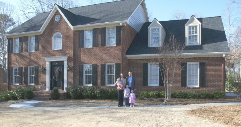 The Dalton family in front of their current 3,500-square-foot home in suburban Atlanta.
