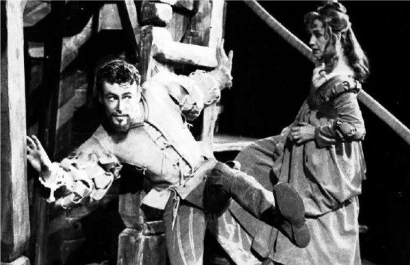 """Peter O'Toole as Petruchio with Peggy Ashcroft as Katherine, in a stage production of Shakespeare's """"The Taming of the Shrew"""" at the Memorial Theatre, Stratford-upon-Avon, in 1960."""