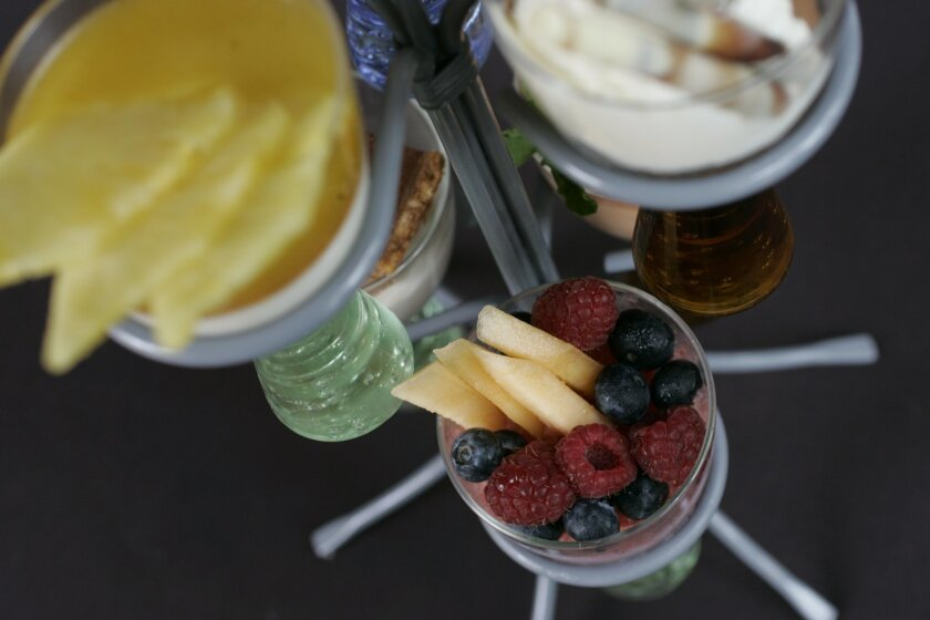 Twenty/20 is known for its extensive wine list, but the menu includes beer and plenty of fresh fruit and produce