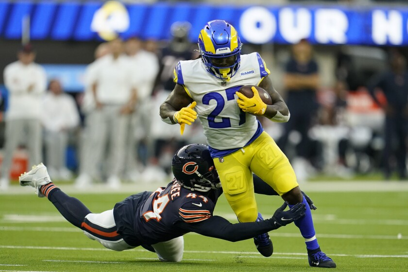 Los Angeles Rams running back Darrell Henderson, above, runs with the ball as Chicago Bears outside linebacker Alec Ogletree defends during the first half of an NFL football game Sunday, Sept. 12, 2021, in Inglewood, Calif. (AP Photo/Marcio Jose Sanchez)