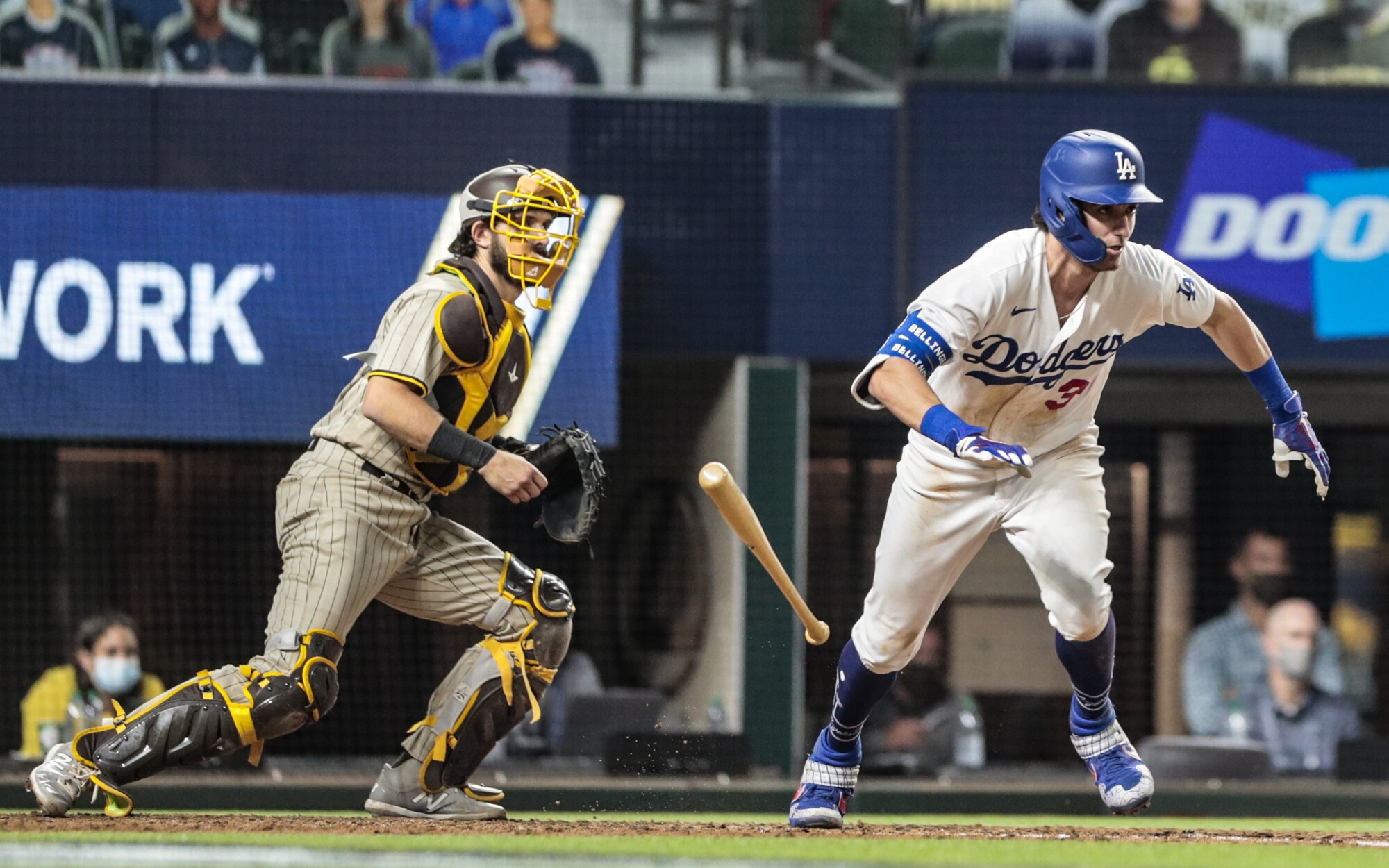 Dodgers center fielder Cody Bellinger reaches base on an error in the fifth inning.