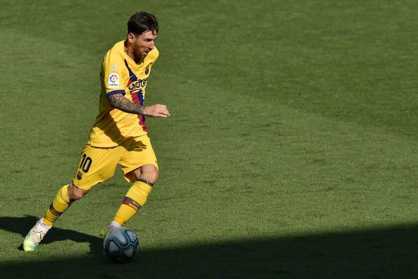 Barcelona's Lionel Messi runs with the ball during the Spanish La Liga soccer match between Alaves and FC Barcelona, at Mendizorroza stadium, in Vitoria, northern Spain, Sunday, July 19, 2020. (AP Photo/Alvaro Barrientos)