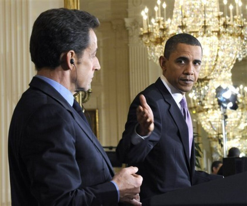 FILE - In this March 30, 2010, file photo, French President Nicolas Sarkozy listens as President Barack Obama speaks in the East Room of the White House in Washington. Sarkozy plans to press Obama Monday, Jan. 10, 2011, to go join Sarkozy in working toward changes in the global financial system.(AP Photo/Susan Walsh, File)